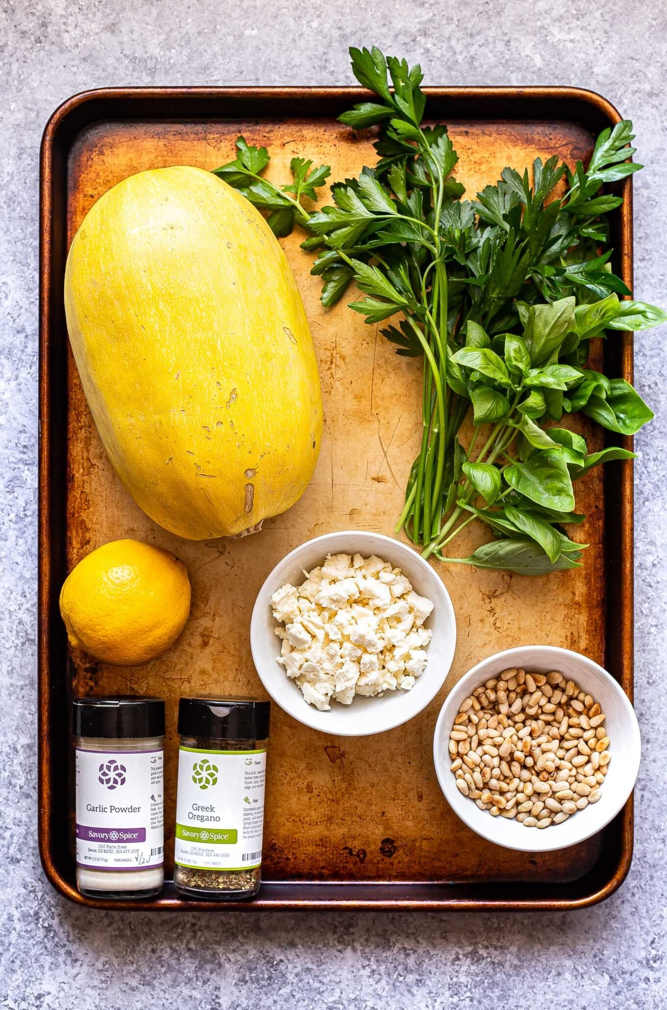 ingredients used to make Spaghetti Squash with Feta and Herbs on a sheet pan.