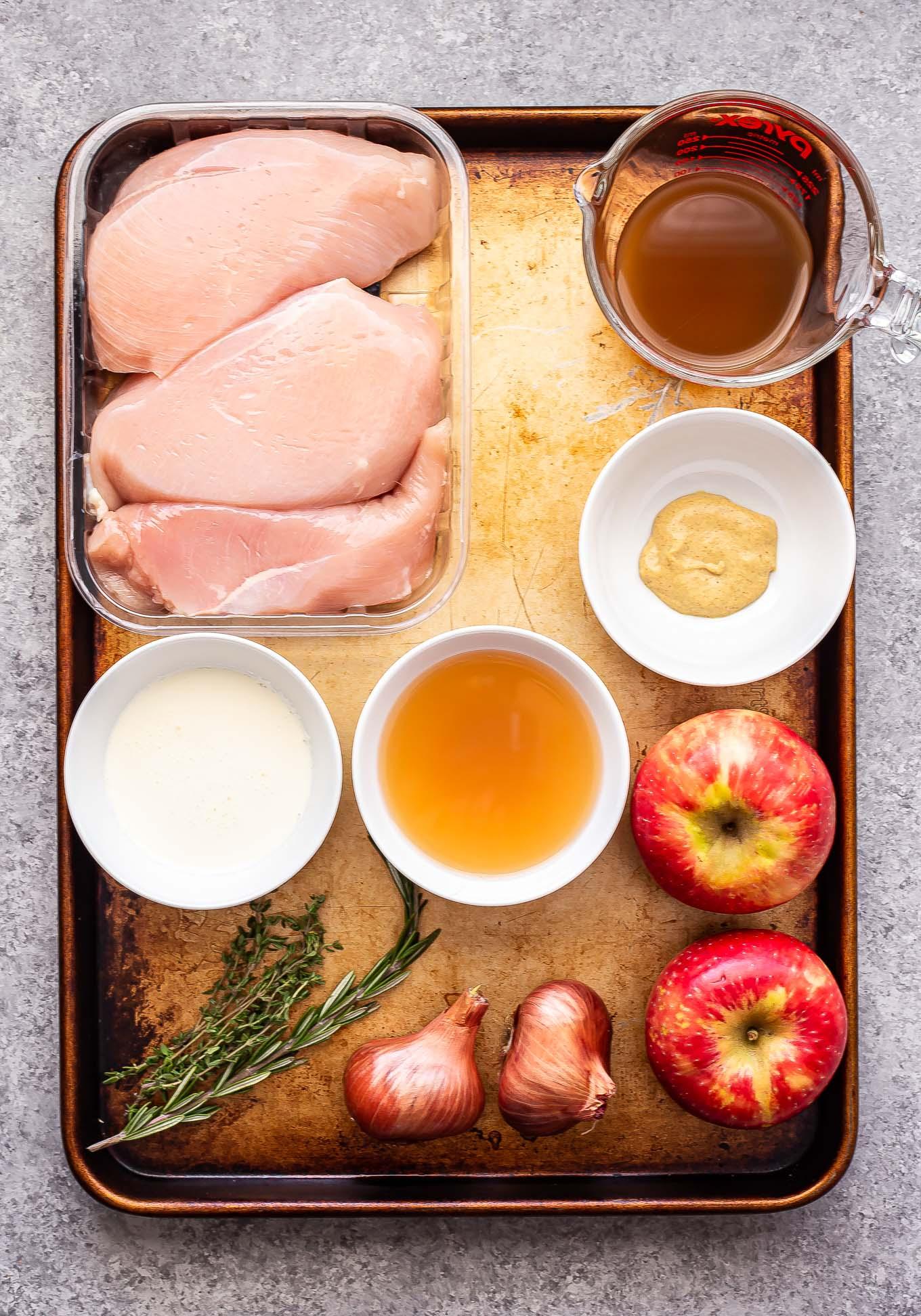 Ingredients for Apple cider chicken skillet on a sheet pan