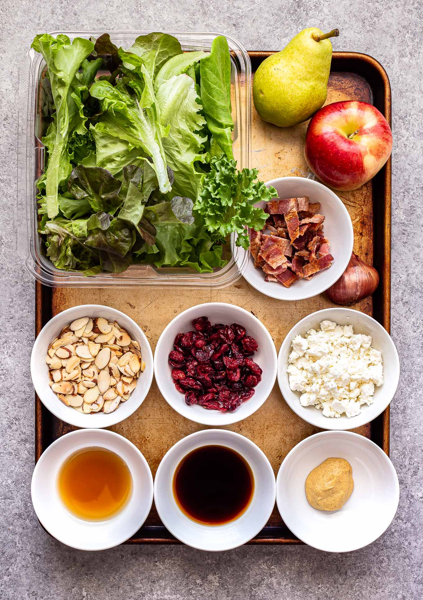ingredients for Autumn Apple and Pear Salad on a sheet pan
