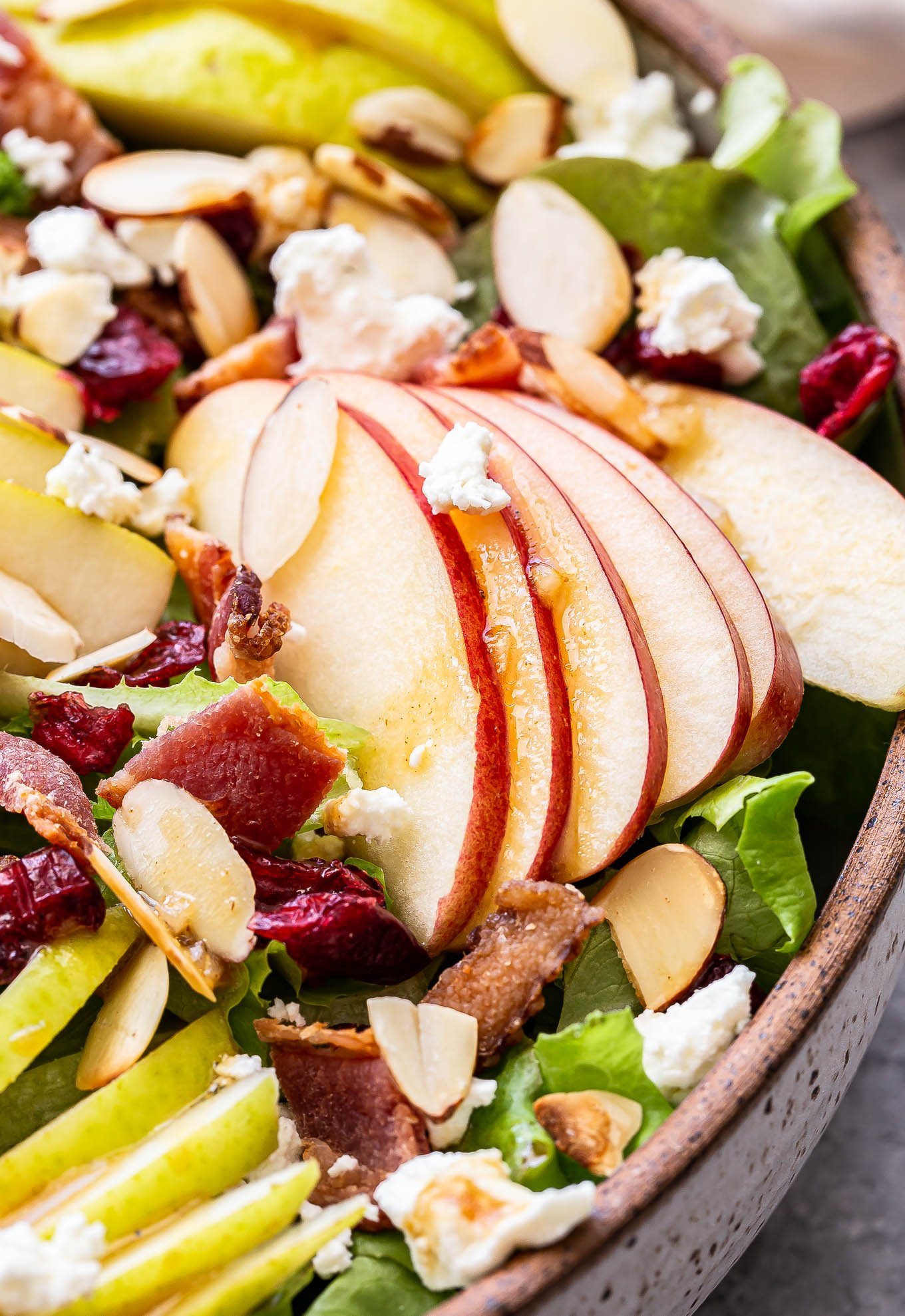 slices of apples fanned out on top of the Autumn Apple and Pear Salad