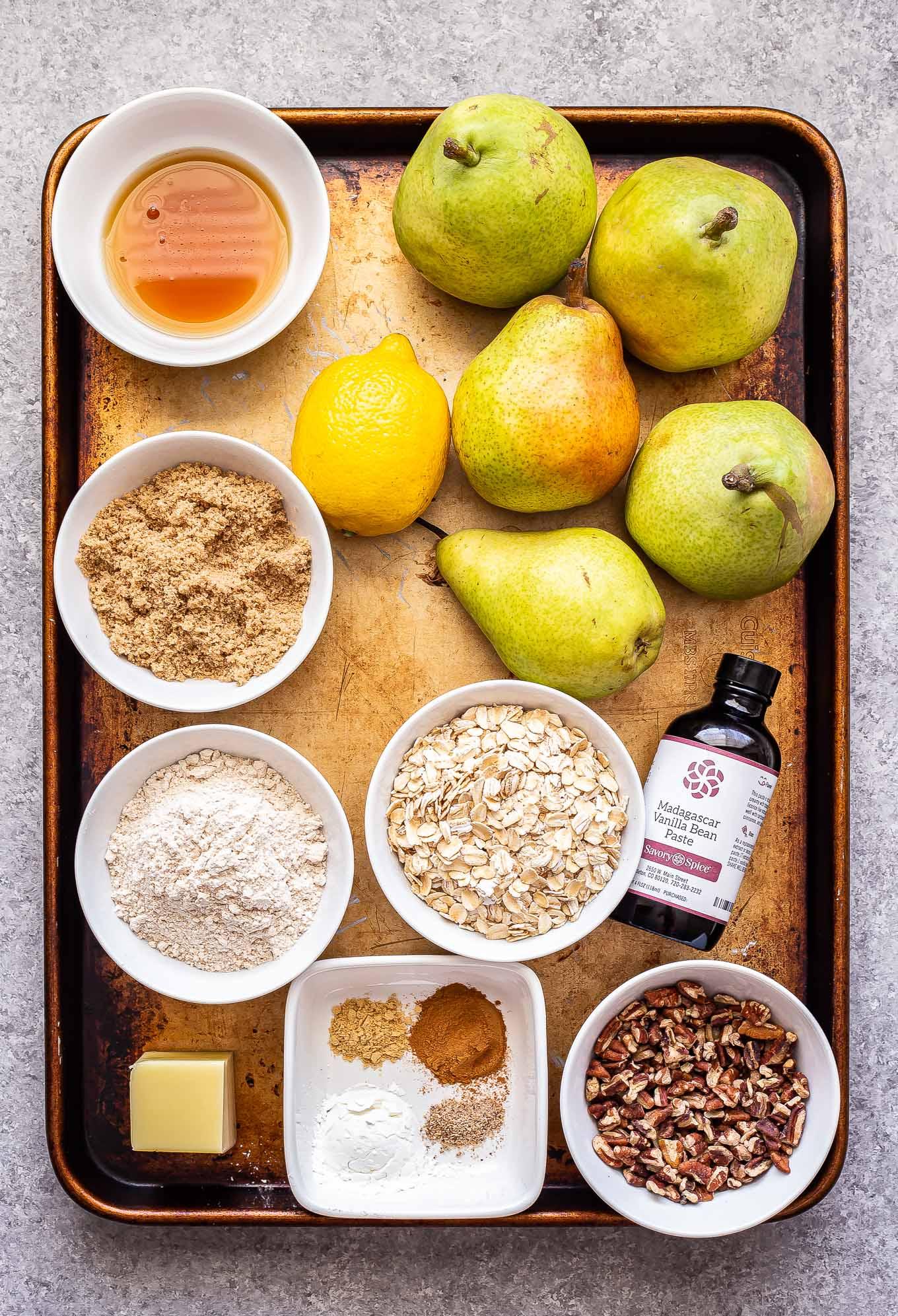 ingredient for Pear Crisp on a sheet pan.